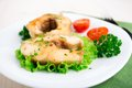 Fried fish and vegetables on a white plate Stock Photo