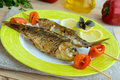 Fried fish (carp) on skewers with pieces pepper Royalty Free Stock Photo