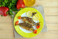 Fried fish (carp) on skewers with pieces pepper and lemon. Royalty Free Stock Photo