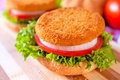 Fried fishburger selective focus on the on top of sandwich Royalty Free Stock Images
