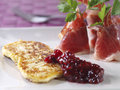 Fried fresh cheese with cured ham and rapsberry ma Royalty Free Stock Image