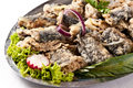 Fried herring dish pieces arranged on metal pieces of fish marinated in vinegar pickle Royalty Free Stock Photos