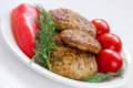 Fried meatballs with dill and tomatoes Royalty Free Stock Photos
