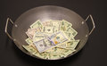 Fried money in the steel pan Royalty Free Stock Images