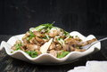 Fried mushrooms with vegetables on a plate Royalty Free Stock Photo