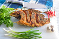 Fried nile tilapia on chopping block thai food Royalty Free Stock Image