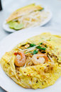 Fried noodle wrapped with eggs, Thai style food Stock Images