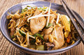 Fried noodles with chicken and vegetables stir as closeup in a bowl Stock Images
