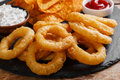 Fried onion rings in batter with sauce chips tortilla Stock Photos