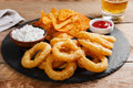 Fried onion rings in batter with sauce  chips Royalty Free Stock Photo