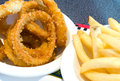 Fried onion rings and french fries Royalty Free Stock Photo