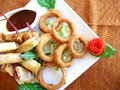 Fried onion rings with Steak dinner Stock Photos