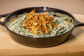Fried onions with beans in a cast iron skillet cooking Royalty Free Stock Image