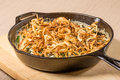 Fried onions in a cast iron skillet cooking Royalty Free Stock Photography