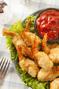 Fried organic coconut shrimp with cocktail sauce Royalty Free Stock Photos