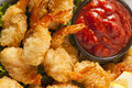 Fried organic coconut shrimp with cocktail sauce Royalty Free Stock Image