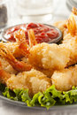 Fried organic coconut shrimp with cocktail sauce Royalty Free Stock Images