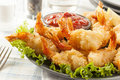Fried organic coconut shrimp with cocktail sauce Stock Photos