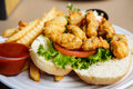 Fried oyster sandwich a fresh hot po boy with french fries Stock Photography