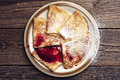 Fried pancakes with jam on vintage wooden background top view Royalty Free Stock Image
