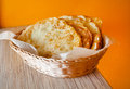 Fried pasties with meat in a basket on an orange background Stock Photos