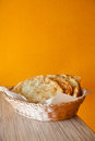Fried pasties with meat in a basket on an orange background Royalty Free Stock Photos