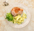 Fried pork chop with potatoes and salad Royalty Free Stock Photo
