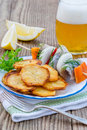 Fried Potato Chips with Slices of Herring Royalty Free Stock Photo