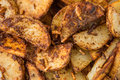 Fried potato slices background texture closeup of sliced wedges Stock Photo