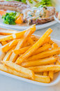 Fried potato in white dish with tamato sauce Royalty Free Stock Photography