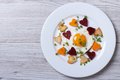 Fried potatoes carrots beets and egg of heart on a plate in the form view from above Royalty Free Stock Photos