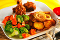 Fried potatoes with vegetables and chicken Stock Photography