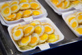 Fried quail eggs package for sale put in ready as snack in market Royalty Free Stock Photo
