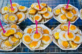 Fried Quail's egg selling in Thailand. Stock Photos