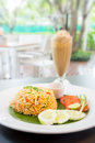 Fried rice with coffee iced in restaurant background selective focus at Royalty Free Stock Photo