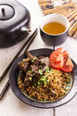 Fried rice with liver as closeup in a black bowl Stock Photography