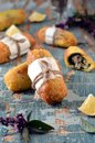 Fried rolls with fish and pesto sauce Royalty Free Stock Images