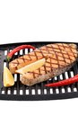 Fried salmon steak on grill. Stock Photography