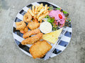 Fried seafood in plate with salad Royalty Free Stock Photo