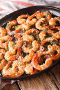 Fried shrimp in garlic sauce with parmesan and herbs closeup. ve Royalty Free Stock Photo