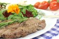 Fried Sirloin steak with wild herb salad Royalty Free Stock Photo