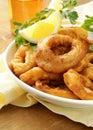 Fried squid rings dipped batter lemon Royalty Free Stock Image