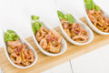Fried squid rings pan with red pepper Stock Images