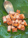 Fried streaky pork place on banana leaf photograph under ambient light from street market Stock Photography