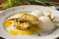 Fried tilapia served with rice on white plate. Royalty Free Stock Photo