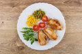 Fried turkey meat, greens, tomatoes, sweet corn, green peas Royalty Free Stock Photo