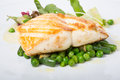 Fried white fish fillet with garnish Royalty Free Stock Photo