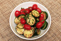 Fried zucchini and tomatoes with herbs Royalty Free Stock Images