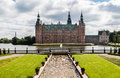 Friederiksborg palace denmark the with its brick walls and green copper roof with towers at the shore of a lake in hillerød and Stock Images