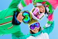 Frieds on ski resort cheerful young friends in winter sportswear Stock Image